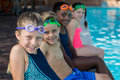 Row Of Friends Sitting At Pool Side Royalty Free Stock Photo - 89677045