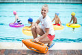 Portrait Of Female Lifeguard Holding Rescue Can At Poolside Royalty Free Stock Photography - 89677417