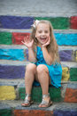 Small Happy Baby Girl In Blue Dress On Colorful Stairs Stock Images - 89687814