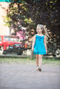 Small Baby Girl With Smiling Face In Blue Dress Outdoor Royalty Free Stock Image - 89687906