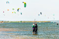 Kitesurfer Trainer At Sunny Black Sea Blaga Beach Resort Trains Woman In Kitesurfing Standing In Calm Shallow Waters Of Firth On D Royalty Free Stock Photos - 89728178