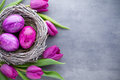 Easter Eggs In The Nest Und Tulip. Gray Background. Royalty Free Stock Photo - 89742755
