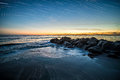 Waves And A Jetty At Sunset In The Atlantic Ocean At Edisto Beac Stock Photo - 89761680