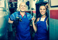 Two Technicians In Coveralls Standing At Car Service Point Royalty Free Stock Image - 89775666