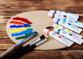 Wooden Art Palette With Tubes Of Oil Paints And A Brush. Art And Craft Tools. Artist`s Brush, Canvas, Palette Knife. Space For Tex Stock Photos - 89795803