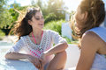 Pretty Woman Sitting With Friend Talking And Laughing Royalty Free Stock Photography - 89798997