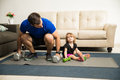 Girl Exercising With Her Father Stock Image - 89822901