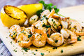 Sauteed Shrimp On Wood Board With Grilled Lemon Wedges Royalty Free Stock Images - 89836019