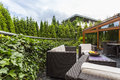 Terrace Surrounded By Lush Garden Stock Images - 89837574