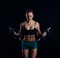 Portrait Of A Young Fitness Woman In Sportswear Doing Workout With Dumbbells On Black Background. Tanned Sexy Athletic Girl. Stock Images - 89854874