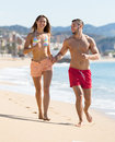 Young Couple Running Near The Sea Stock Image - 89857771