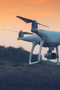 Drone Quad Copter With Digital Camera At Sunset Ready To Fly For Royalty Free Stock Image - 89865856