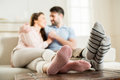Couple Hugging On Sofa At Home Royalty Free Stock Image - 89874846