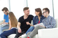 Group Of Young People In Casual Clothes Chatting And Having Fun Royalty Free Stock Photography - 89899737