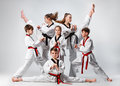 The Studio Shot Of Group Of Kids Training Karate Martial Arts Royalty Free Stock Photography - 89902907