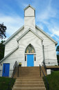 White Church With Blue Doors And Stained Glass Stock Images - 89923724