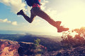 Jumping Over Precipice Between Two Rocky Mountains At Sunset Royalty Free Stock Images - 89924999