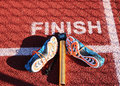 Finish Line With Spikes, Baton And Stopwatch Stock Image - 89932571