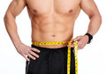 Man Abdomen With Measuring Tape Over Blue Background. Stock Image - 89937071