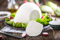Cow Cheese. Fresh White Cow Cheese With Lettuce Salad Radish Salt Pepper And Olive Oil Stock Photography - 89942712