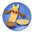 Cow Made Of Black Bread And Cheese On Blue Plate Royalty Free Stock Photo - 90010505