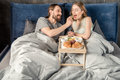 Couple Has Breakfast In Bed Stock Photo - 90042190