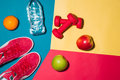 Sport Concept. Fitness Equipment. Sneakers, Water, Apple, Dumbbe Stock Image - 90098521