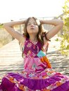 Hippy Purple Dress Teen Girl Relaxed Outdoors Royalty Free Stock Photo - 9013245