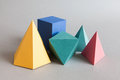 Colorful Platonic Solids, Abstract Geometric Figures On Gray Background. Pyramid Prism Rectangular Cube Yellow Blue Pink Stock Image - 90108211