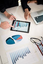 Professional Team Analyzing Bar Chart Displayed On Tablet PC Royalty Free Stock Photos - 90120638