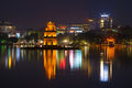 Turtle Tower Against The Backdrop Of The City Waterfront Of Hoan Kiem Lake Stock Images - 90136644