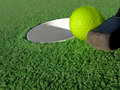 Miniature Golf Ball And Putt Near Hole Stock Photography - 9021482