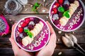 Blueberry Smoothie Bowl With Banana, Raspberry, Pitaya, Blackberry, Almonds, Sunflower And Chia Seeds Royalty Free Stock Photos - 90220998