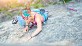 Concentrated Girl In A Rock Climbing Passage Royalty Free Stock Photo - 90238075