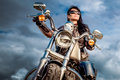Biker Girl On A Motorcycle Stock Images - 90245354