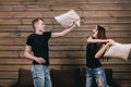 Happy Couple Having Pillow Fight In Room Stock Image - 90265891
