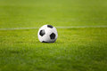 The Soccer Ball On Stadium Green Field. Football Pitch In The Background Royalty Free Stock Photo - 90271215
