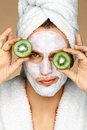 Man With Facial Mask And Kiwi Slices On His Eyes. Royalty Free Stock Image - 90272046