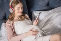 Pregnant Woman With Headphones Royalty Free Stock Photos - 90275658