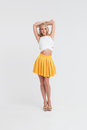 Girl With Perfect Body In Yellow Skirt On White Background Stock Photos - 90284533