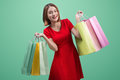 Beautiful Young Asian Woman With Colored Shopping Bags Over Blue Royalty Free Stock Photo - 90349435