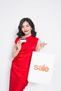 Beautiful Asian Woman Wearing A Red Dress With Shopping Bag And Stock Photography - 90350112