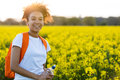 Mixed Race African American Girl Teenager In Yellow Flowers At S Stock Photography - 90364062