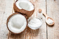 Fresh Coconut With Cosmetic Oil In Jar On Wooden Background Royalty Free Stock Images - 90399719