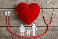 Red Heart, Stethoscope And Paper Chain Family On Wooden Table Stock Image - 90403651
