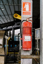 Fire Extinguisher Tank Is Very Old. Hanging On A Pole In The Fac Royalty Free Stock Photography - 90407617