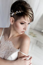 Morning Beautiful Delicate Bride With Sexy Short Hair With A Gentle Little Wreath On His Head In A White Silk Lingerie Sits In A W Stock Photos - 90409263