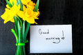 Yellow Daffodil Flowers And Quotes Good Morning On White Rustic Table. Mothers Day Or Womens Day. Greeting Card. Top View. Love. Royalty Free Stock Photos - 90409728