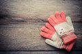 Winter Gloves Orange Color On Wooden Background - Tone Vintage. Royalty Free Stock Photography - 90418647