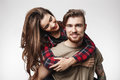 Closeup Of Man Looking Straight, Girl Sitting On Man`s Back. Royalty Free Stock Photos - 90422038